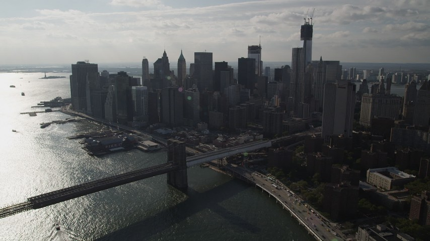 4K stock footage aerial video of approaching Brooklyn Bridge and Lower Manhattan skyscrapers, New York Aerial Stock Footage | AX88_126