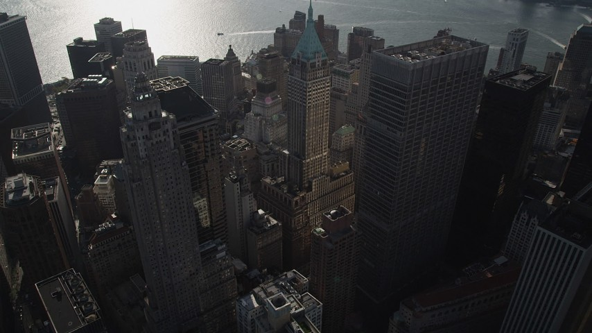 4K stock footage aerial video of approaching 40 Wall Street and Lower Manhattan skyscrapers, New York, New York Aerial Stock Footage | AX88_129