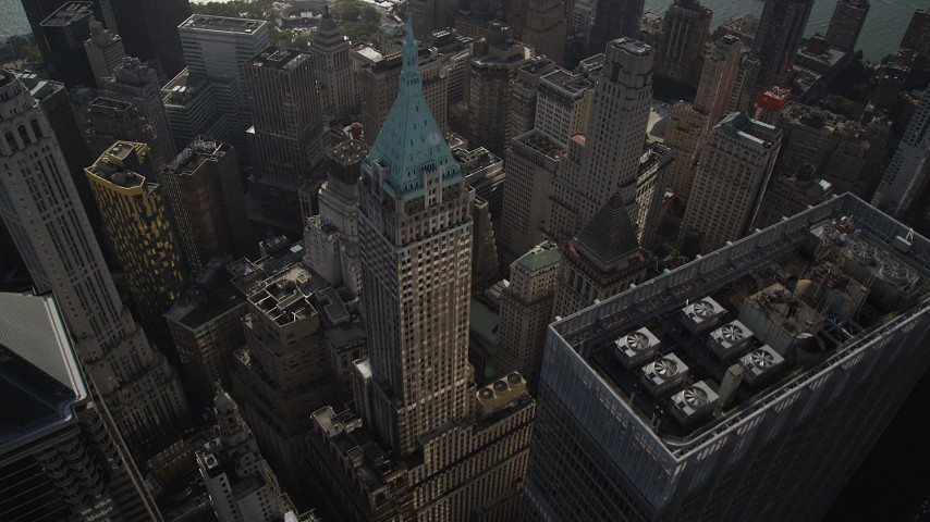 4K stock footage aerial video of flying over 40 Wall Street and Lower Manhattan skyscrapers, New York, New York Aerial Stock Footage | AX88_130