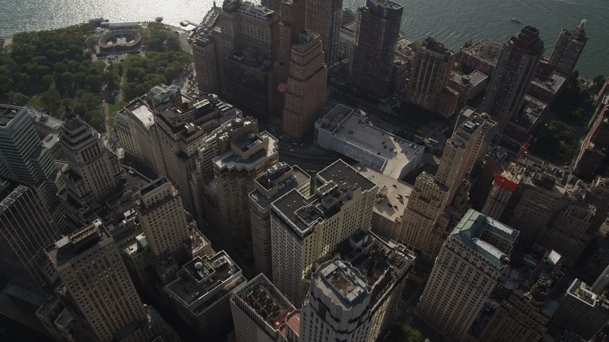 4K stock footage aerial video of flying over Lower Manhattan skyscrapers by Hudson River, New York, New York Aerial Stock Footage | AX88_131