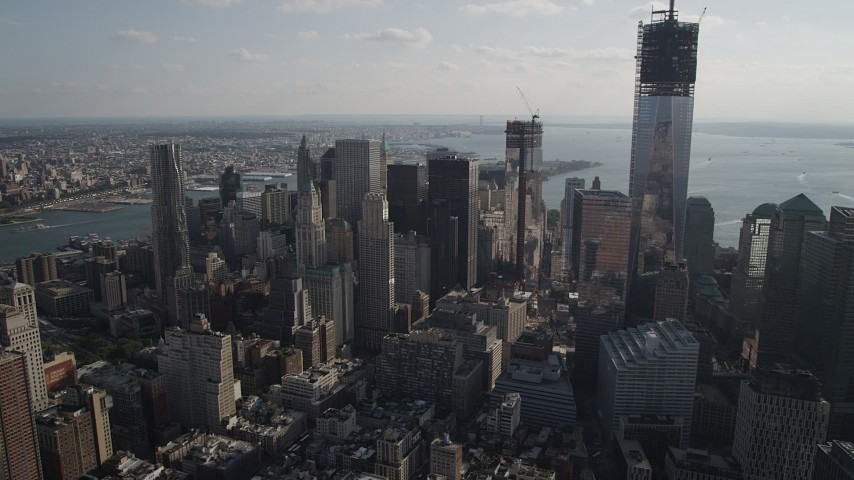 4K stock footage aerial video of flying by Lower Manhattan skyscrapers, New York, New York Aerial Stock Footage | AX88_138