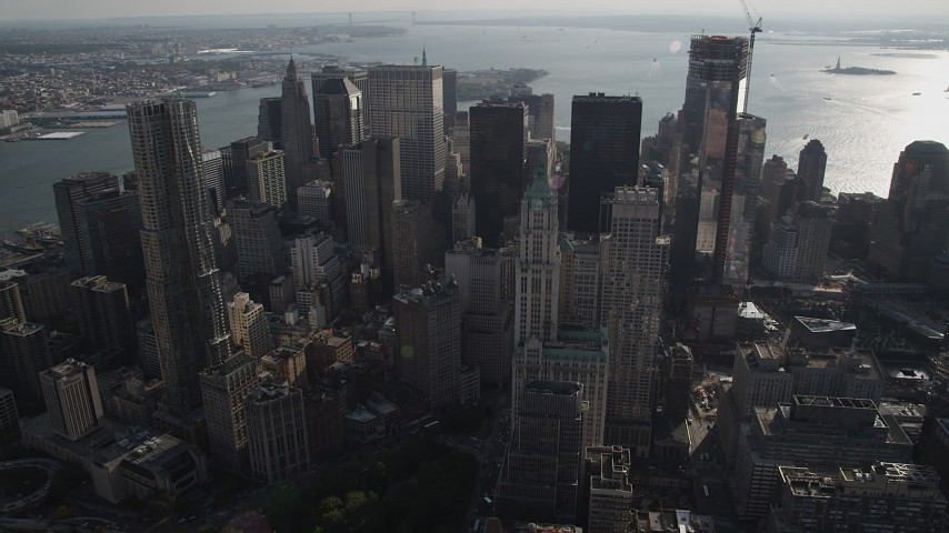 4K stock footage aerial video of flying by Woolworth Building and 8 Spruce Street skyscrapers, Lower Manhattan, New York Aerial Stock Footage | AX88_139
