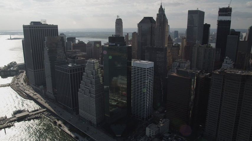 4K stock footage aerial video of flying by Lower Manhattan skyscrapers, seen from East River, New York, New York Aerial Stock Footage | AX88_142