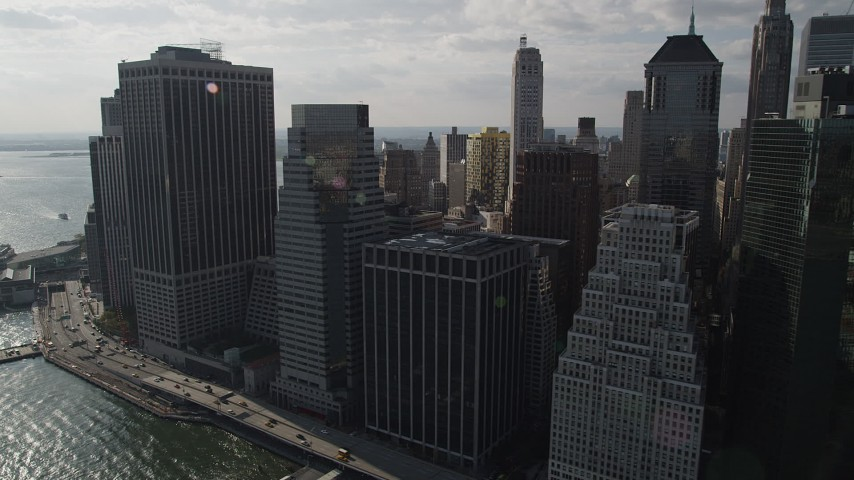 4K stock footage aerial video of flying by waterfront skyscrapers by East River, Lower Manhattan, New York, New York Aerial Stock Footage | AX88_143