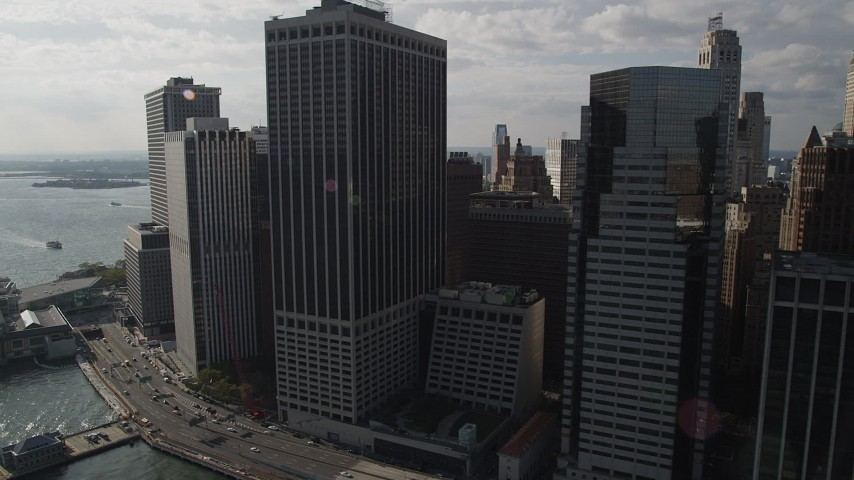 4K stock footage aerial video of flying by skyscrapers in Lower Manhattan by the East River, New York, New York Aerial Stock Footage | AX88_144