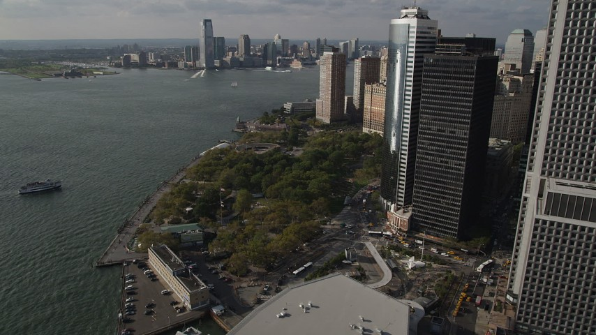 4K stock footage aerial video of approaching Battery Park by skyscrapers in Lower Manhattan, New York, New York Aerial Stock Footage | AX88_145