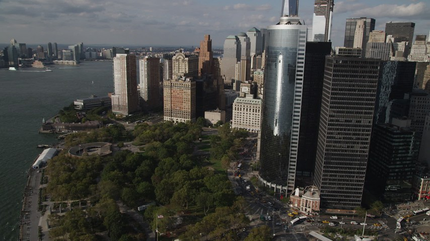4K stock footage aerial video fly over Battery Park with view of Lower Manhattan skyscrapers, New York, New York Aerial Stock Footage | AX88_146