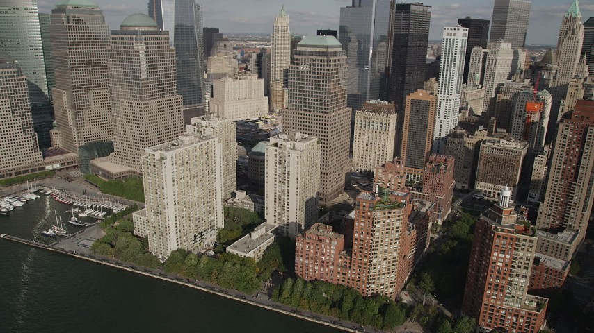 4K aerial video of flying by World Trade Center Towers and skyscrapers in Lower Manhattan, New York Aerial Stock Footage | AX88_150