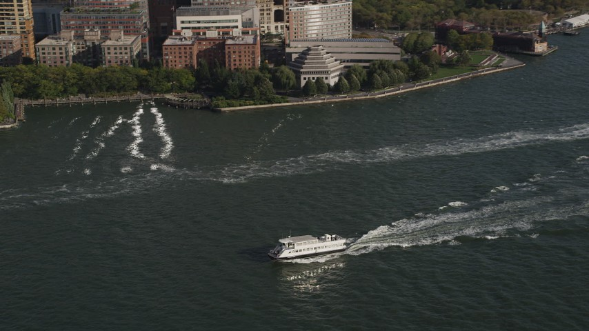 4K stock footage aerial video of tracking a ferry on the Hudson River, Lower Manhattan, New York, New York Aerial Stock Footage | AX88_156