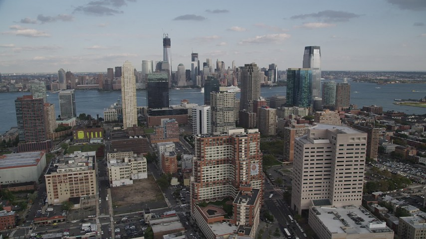 4K stock footage aerial video of city skyscrapers and Lower Manhattan skyline in background, Downtown Jersey City, New Jersey Aerial Stock Footage | AX88_172