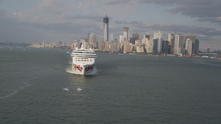 4K stock footage aerial video of flying by cruise ship sailing New York Harbor, revealing Lower Manhattan skyline, New York Aerial Stock Footage | AX88_193