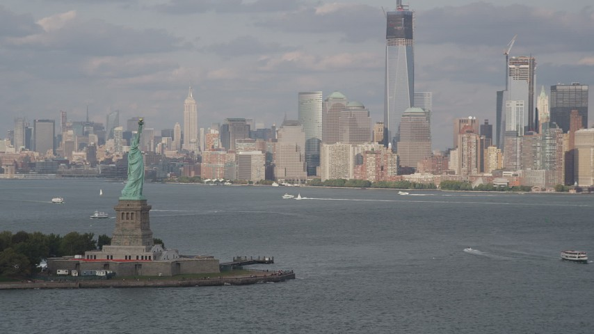 4K aerial video orbit Statue of Liberty, revealing Lower Manhattan skyline, New York Aerial Stock Footage | AX88_195