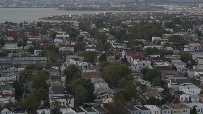 4K stock footage aerial video of flying by urban residential neighborhoods, Jersey City, New Jersey Aerial Stock Footage | AX88_198