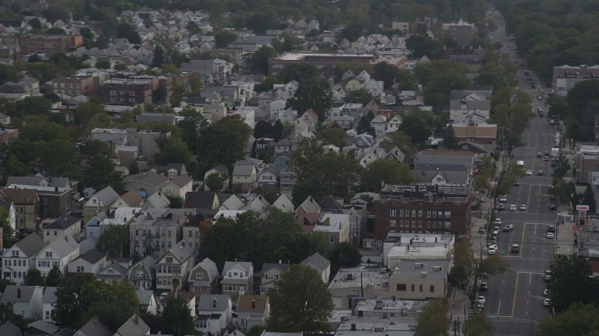 5K aerial video of passing by urban residential neighborhoods, Jersey City, New Jersey Aerial Stock Footage | AX88_200