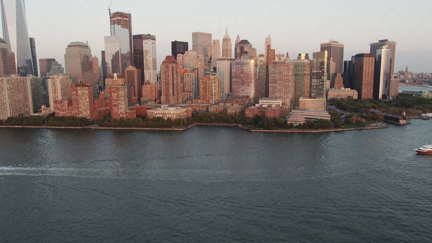 4K stock footage aerial video Flying New York Harbor, revealing Lower Manhattan, New York, New York, sunset Aerial Stock Footage | AX89_003