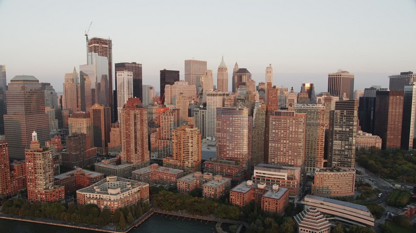 4K stock footage aerial video Approaching Lower Manhattan skyscrapers, New York, New York, sunset Aerial Stock Footage | AX89_004