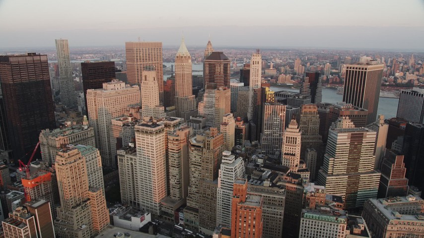 4K stock footage aerial video Fly over Lower Manhattan, approach 40 Wall Street, New York, New York, sunset Aerial Stock Footage | AX89_005
