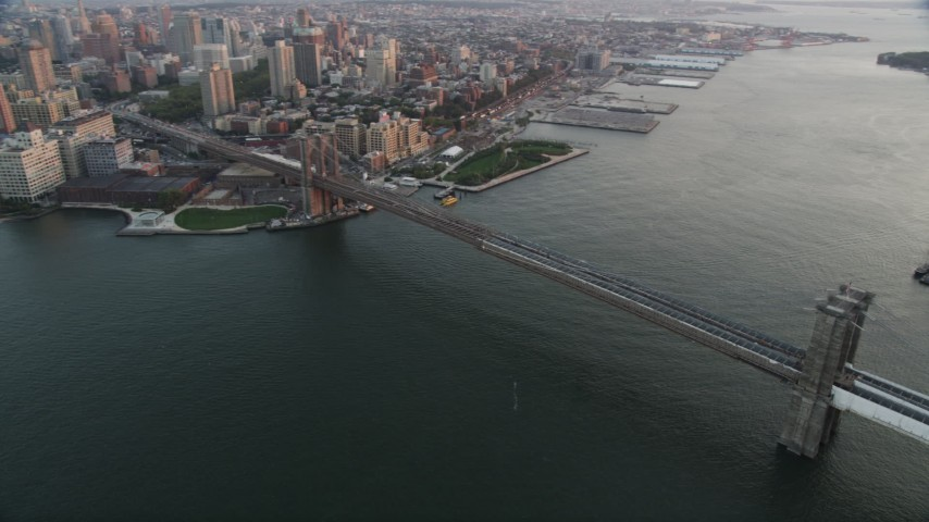 4K stock footage aerial video Flying by Brooklyn Bridge, East River, New York, New York, sunset Aerial Stock Footage | AX89_009