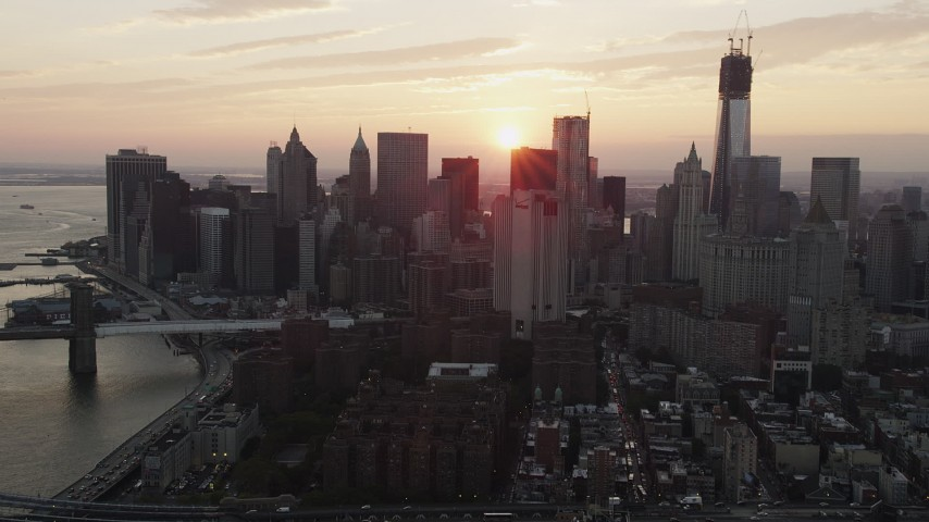 4K stock footage aerial video Flying by Lower Manhattan skyscrapers, New York, New York, sunset Aerial Stock Footage | AX89_013