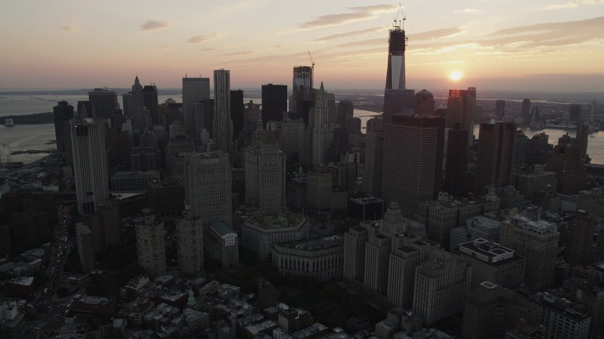 4K stock footage aerial video Flying by Lower Manhattan skyscrapers, New York, New York, sunset Aerial Stock Footage | AX89_016