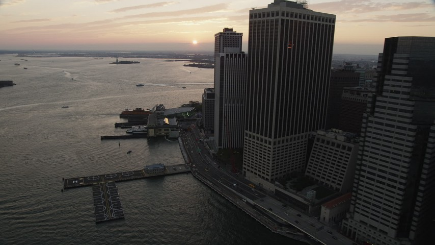 4K stock footage aerial video Flying by Staten Island Ferry, New York Harbor, Lower Manhattan, New York, sunset Aerial Stock Footage | AX89_018