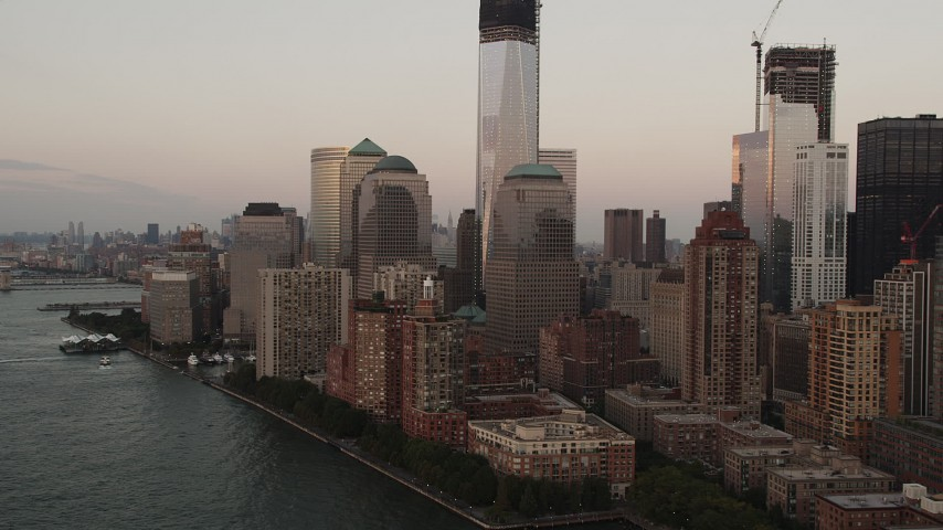 4K aerial video Fly by One and Two World Financial Center, Lower Manhattan, New York, sunset Aerial Stock Footage | AX89_022
