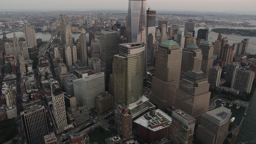 5k aerial video of World Trade Center, skyscrapers, Lower Manhattan, New York, sunset Aerial Stock Footage | AX89_025