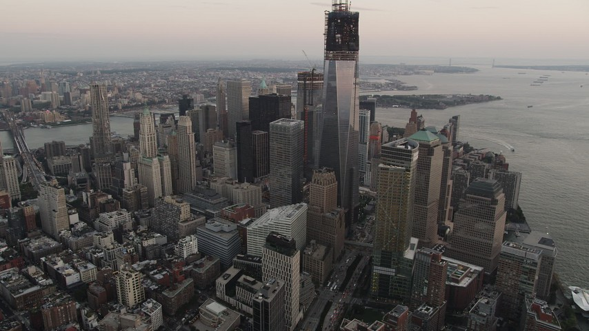 4K stock footage aerial video Flying by World Trade Center, Lower Manhattan skyscrapers, New York, sunset Aerial Stock Footage | AX89_026