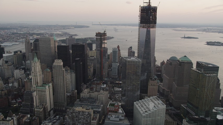 5k aerial video Flying by Four World Trade Center, Lower Manhattan, New York, New York, sunset Aerial Stock Footage | AX89_028