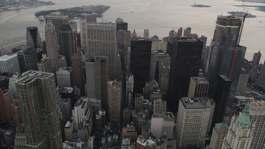 4K stock footage aerial video Flying by Lower Manhattan skyscrapers, New York, New York, twilight Aerial Stock Footage | AX89_030