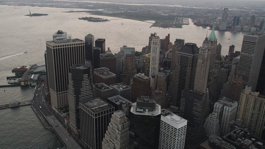 4K stock footage aerial video Flying by Lower Manhattan skyscrapers, East River, New York, New York, twilight  Aerial Stock Footage | AX89_032
