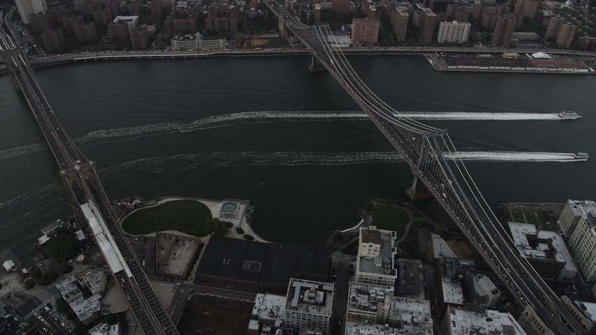 4K aerial video Flying by Brooklyn Bridge, Manhattan Bridge, East River, New York, twilight Aerial Stock Footage | AX89_033