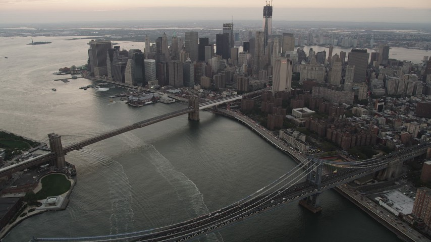 4K stock footage aerial video of the Brooklyn Bridge, Manhattan Bridge, Lower Manhattan, New York, twilight Aerial Stock Footage | AX89_035