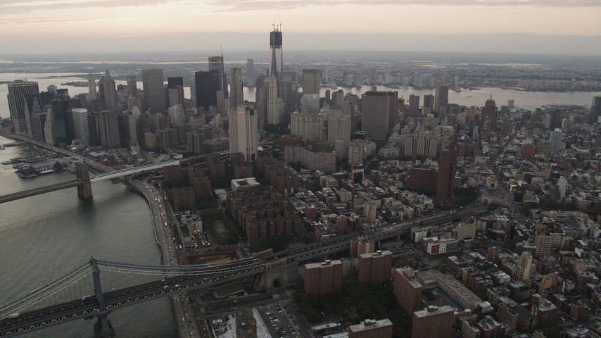 4K stock footage aerial video Flying by Lower Manhattan, from Lower East Side, New York, twilight Aerial Stock Footage | AX89_036