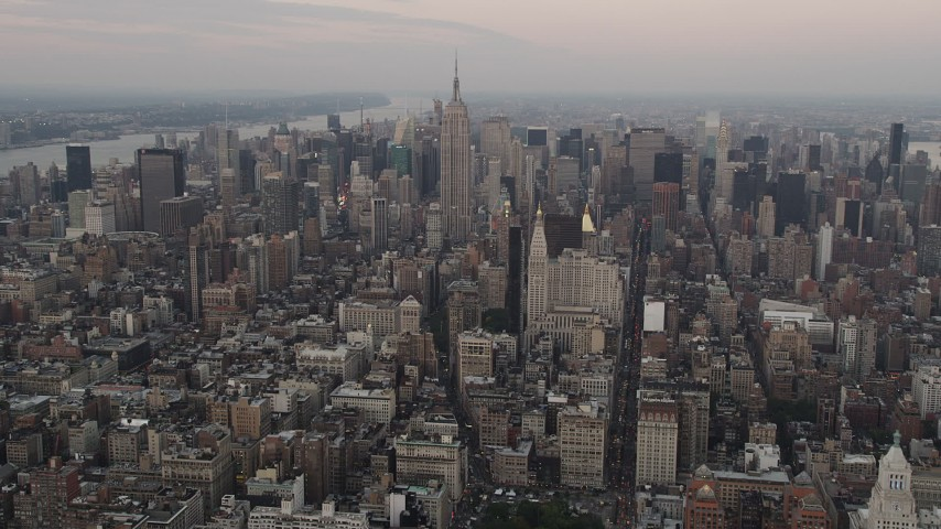4K stock footage aerial video Flying by Midtown Manhattan, Empire State Building, New York, New York, twilight Aerial Stock Footage | AX89_040