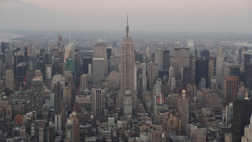 4K stock footage aerial video Flying by Empire State Building, Midtown Manhattan, New York, New York, twilight Aerial Stock Footage | AX89_041