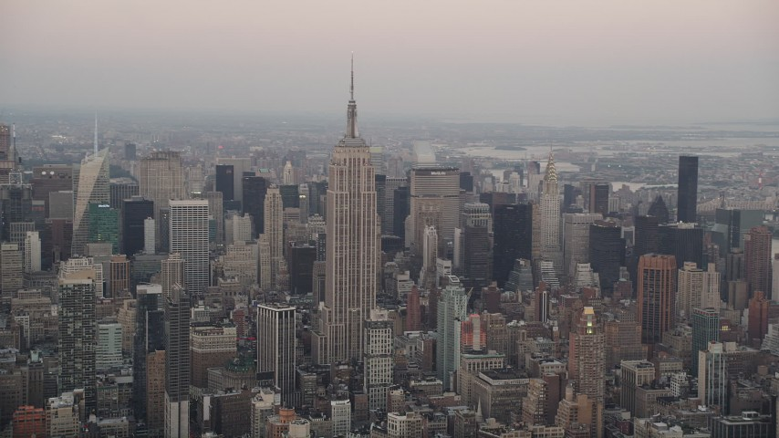 4K stock footage aerial video Flying by Empire State Building, Midtown Manhattan, New York, New York, twilight Aerial Stock Footage | AX89_042