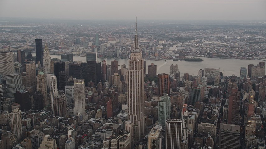 4K stock footage aerial video Approaching Empire State Building, Midtown Manhattan, New York, twilight Aerial Stock Footage | AX89_043