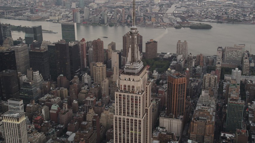 4K stock footage aerial video Flying by the Empire State Building, Midtown Manhattan, New York, twilight Aerial Stock Footage | AX89_045