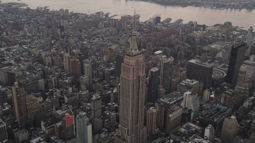 4K stock footage aerial video Approaching Empire State Building, Midtown Manhattan, New York, twilight Aerial Stock Footage | AX89_048