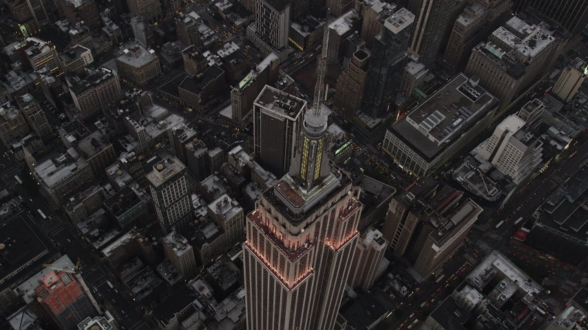 4K stock footage aerial video of a Bird's eye view over Empire State Building, Midtown Manhattan, New York, twilight Aerial Stock Footage | AX89_050
