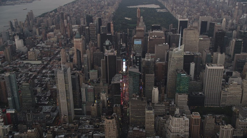 4K aerial video Flying by Times Square, Midtown Manhattan, New York, New York, twilight Aerial Stock Footage | AX89_051