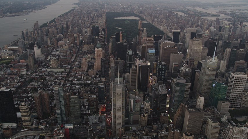 4K stock footage aerial video Approaching Midtown Manhattan skyscrapers, New York, New York, twilight Aerial Stock Footage | AX89_052