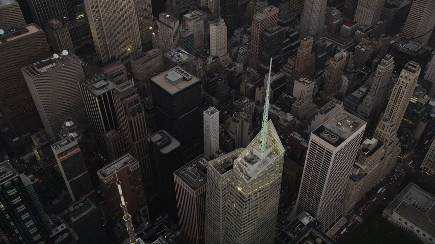 4K stock footage aerial video Approaching Bank of America Tower, Midtown Manhattan, New York, twilight Aerial Stock Footage | AX89_054