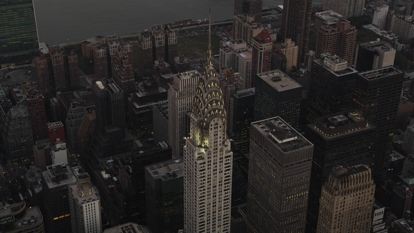 4K stock footage aerial video Flying by the Chrysler Building, Midtown Manhattan, New York, New York, twilight Aerial Stock Footage | AX89_055