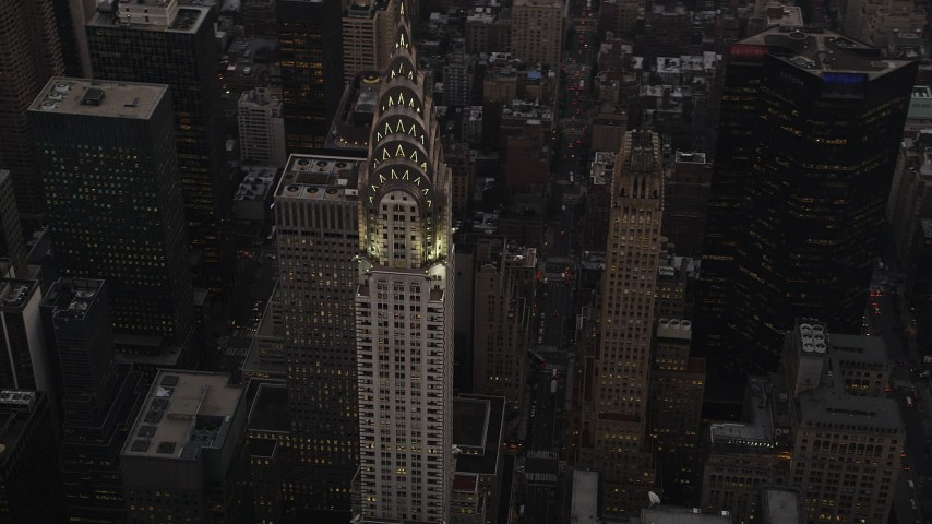 4K aerial video Flying by Chrysler Building, Midtown Manhattan, New York, New York, twilight Aerial Stock Footage | AX89_056