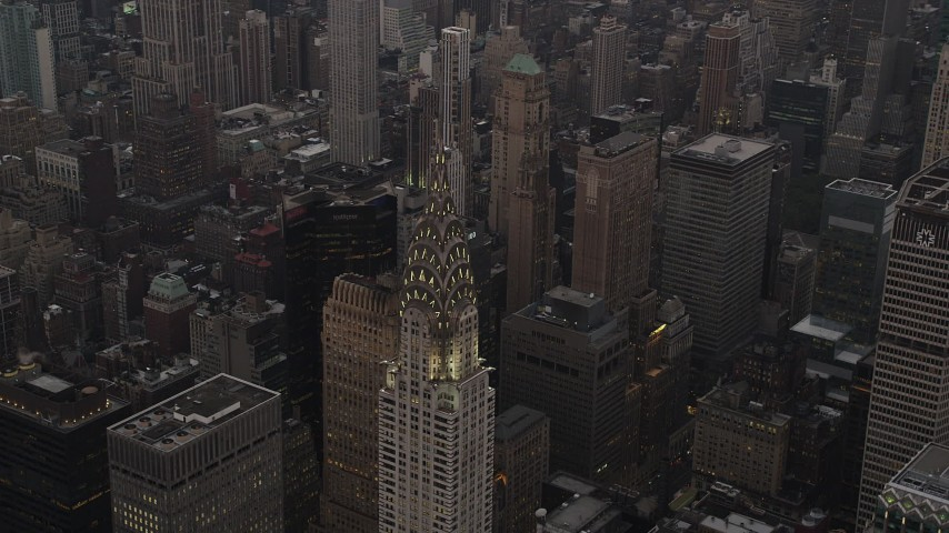 5k aerial video Flying by the Chrysler Building, Midtown Manhattan, New York, New York, twilight Aerial Stock Footage | AX89_058