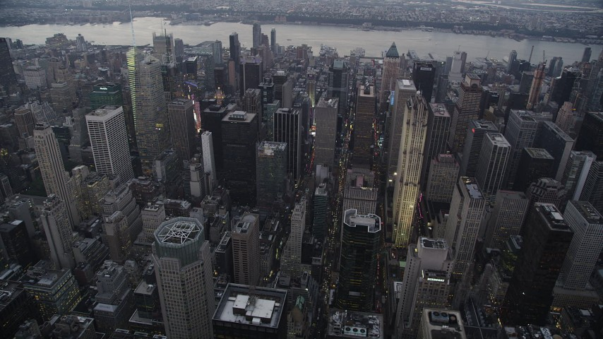 4K stock footage aerial video Flying by skyscrapers, Midtown Manhattan, New York, New York, twilight Aerial Stock Footage | AX89_064