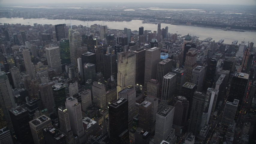 4K stock footage aerial video Flying by skyscrapers, Midtown Manhattan, New York, New York, twilight Aerial Stock Footage | AX89_065
