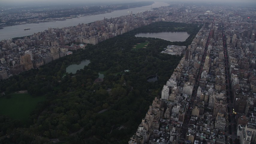 4K stock footage aerial video Approaching Central Park, from Upper East Side, New York, twilight Aerial Stock Footage | AX89_066